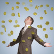 Businessman spread his arms. Money fall from above — Stock Photo #54225149