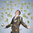 Businessman spread his arms. Money fall from above — Stock Photo #54225537
