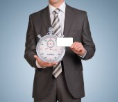 Businessman in suit hold empty card and stopwatch — Stock Photo