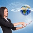 Beautiful businesswoman using tablet and Earth with figures — Stock Photo #54397883