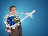 Businessman holding earth with buildings — Foto de Stock
