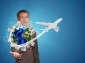Businessman holding earth with buildings — Stock Photo