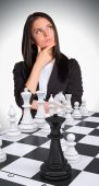 Lost in thought woman looking up. Chessboard with chess — Stock Photo