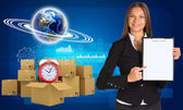 Businesswoman with Earth and heap of cardboard boxes — Stock Photo