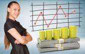 Businesswoman and dollar packs with yellow barrels — Stock Photo