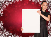 Businesswoman holding empty paper. Christmas backgrond — Stock Photo