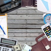 Office objects, tablet pc and smartphone lying on old wooden boards — Stock Photo