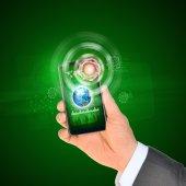 Man hand using smart phone. Earth on phone screen — Stock Photo