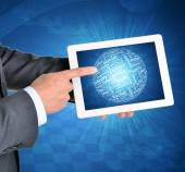 Man hands using tablet pc. Sphere of business words on touch screen — Stock Photo