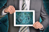 Man hands using tablet pc. Money and sphere of business words on touch screen — Stock Photo