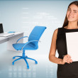 Businesswoman hold paper sheet. Office table with chair and laptop are located next — Stock Photo #57190399