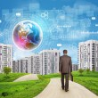 Businessman walking along road through green hills towards city. Brightly coloured planet, charts and other virtual items in sky. — Stock Photo #59415815