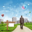 Businessman walking along road running through green hills towards city. Brightly coloured planet, charts, diagrams and other virtual items in sky — Stock Photo #59415967