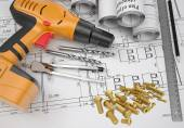 Electric screwdriver, fastening hardware, borers, some draftsmans instruments, scrolled drafts, architectural drawing — Stock Photo