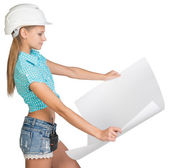 Beautiful woman builder holding in front of him large paper sheet — Stock Photo