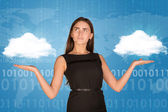 Businesswoman holding two white clouds, as if chosing — Stock Photo