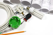 Drawing rolls, electrical hardware tools and appliances composition — Stock Photo