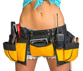 Woman wearing tool belt with tools, close up — Stock Photo