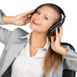 Businesswoman in headset with her hands on speakers — Stock Photo #63158605