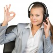 Businesswoman in headset making okay gesture — Stock Photo #63159191