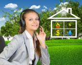 Businesswoman in headset, symbols of public utilities beside — Stock Photo