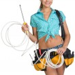 Woman in hard hat and tool belt holding coil of cable — Stock Photo #63989531