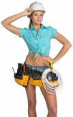 Woman in hard hat and tool belt posing — Stock Photo