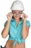 Woman in hard hat and protective glasses — Stock fotografie