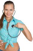 Woman using stethoscope on herself — Stock fotografie