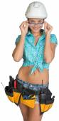 Woman in hard hat, tool belt and protective glasses — Stock fotografie