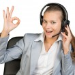 Businesswoman in headset making okay gesture — Stock Photo #64203039