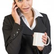 Businesswoman holding mug, talking on the phone — Stock Photo #64207079
