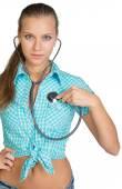 Woman using stethoscope on herself — Stock Photo
