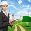 Businesswoman in hard hat, writing on clipboard — Stock Photo #64384409