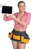 Woman in tool belt showing tablet PC with blank screen — Stockfoto