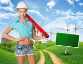 Woman in hard hat, holding large spirit level — Stock Photo