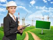 Businesswoman in hard hat, writing on clipboard — Stock Photo