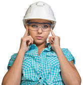 Woman in hard hat and protective glasses — Stock Photo