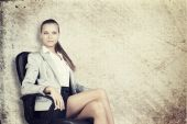 Businesswoman in office chair, looking at camera — Stock Photo