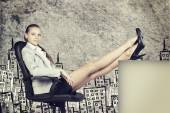 Businesswoman in office chair with her feet up on anything — Stok fotoğraf