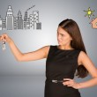 Woman making choice between city and country, looking at keys in her hand — Stock Photo #65977191