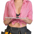Woman in tool belt holding tablet PC on her palms — Stock Photo #65985583