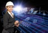 女商人在头盔控股剪贴板,微笑。工业园区作为背景 — 图库照片