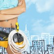 Woman in tool belt with different tools. Cropped image. Sketch buildings as backdrop — Stock Photo #66195653