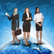 Business womens in suits, blouses, skirts, smiling and looking at camera. Against backdrop of globe, different icons — Stock Photo #67867681