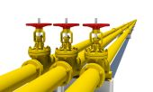 Three yellow pipes with valves — Stock Photo