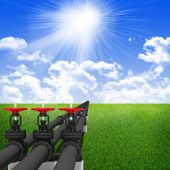 Three industrial pipes for oil transfer. Against background of blue sky , clouds, green grass — Stock Photo