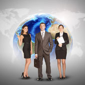 Business women and men in suits, smiling. Against background of globe, world map — Foto de Stock