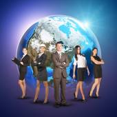 Business women and men in suits, smiling. Against background of globe earth — Foto de Stock