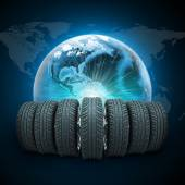 Wedge of new car wheels. Earth with light and world map — Stock Photo